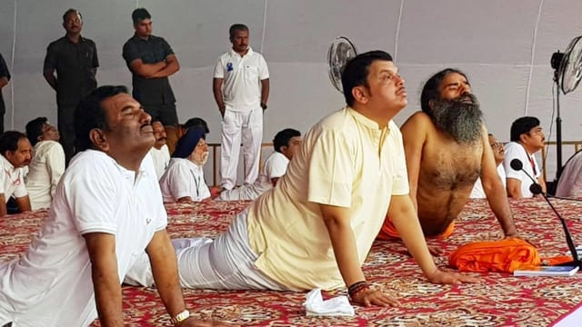 CM Fadnavis performs Yoga with Baba Ramdev, watch video